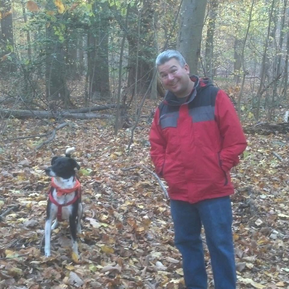 Steve and dog, Scout, in the woods