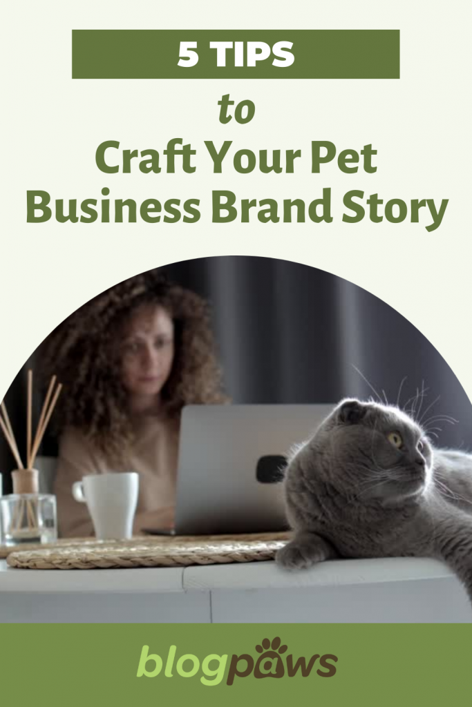 Woman at desk behind computer with grey cat on desk headline: 5 Tips to Craft Your Pet Business Brand Story