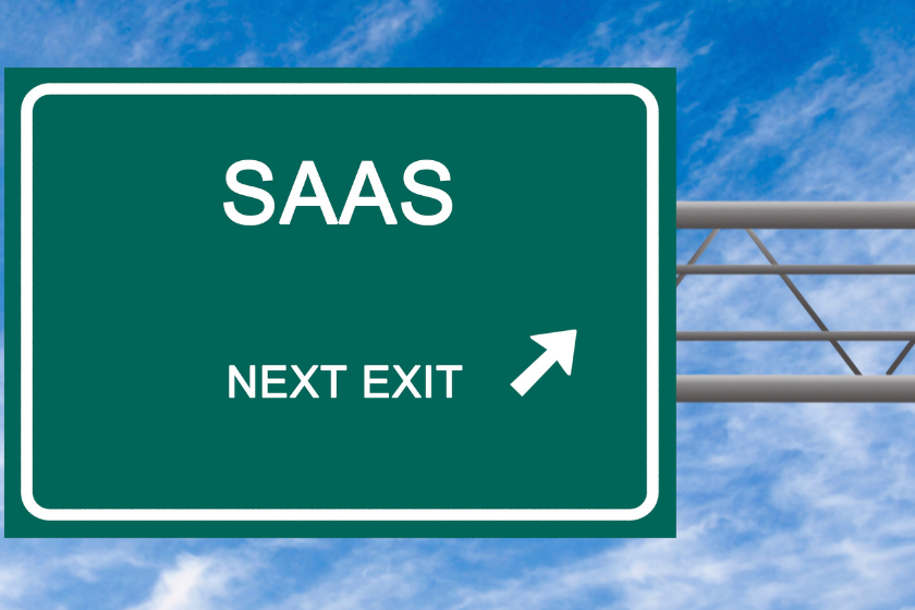 Green road sign that says SAAS Next exit